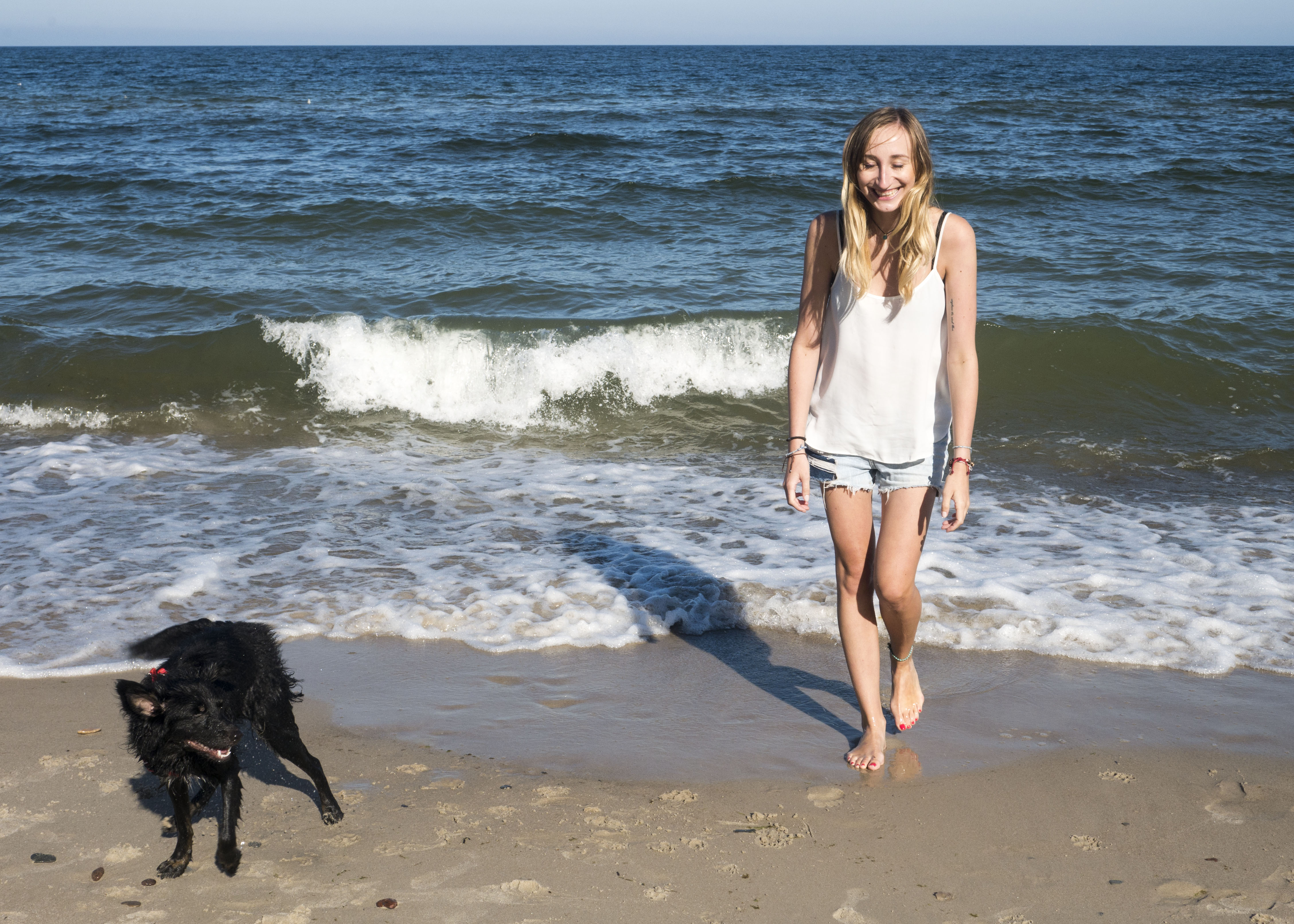 girl and dog by the sea, Baltic